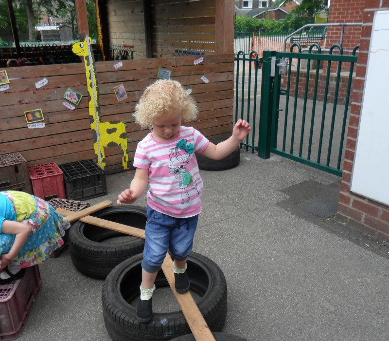 Balance and team work in the nursery's outside play area
