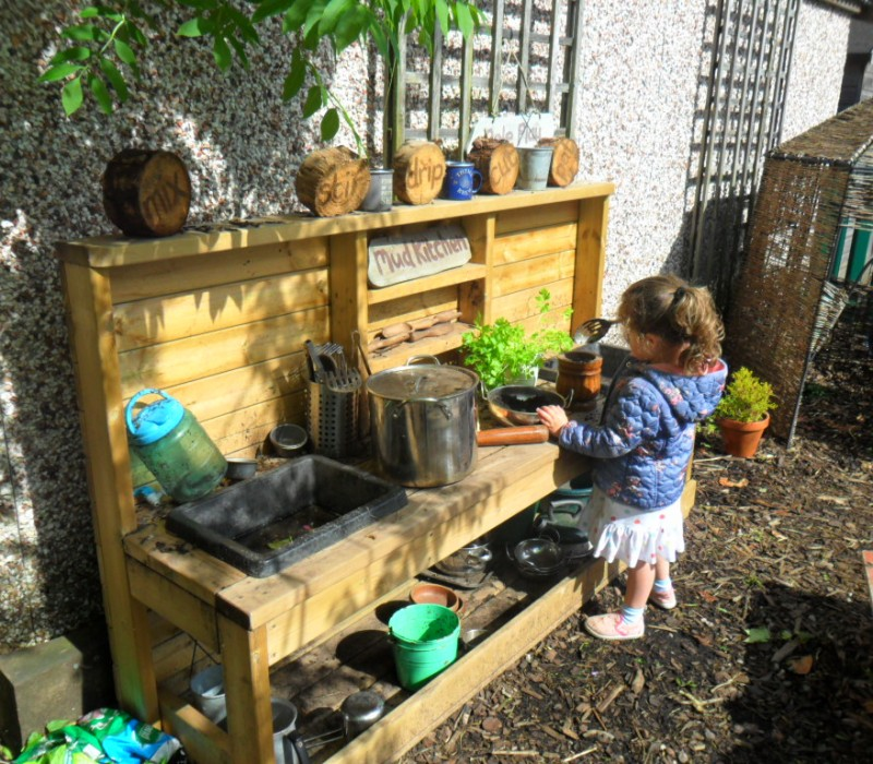 The mud kitchen a great hit with the children